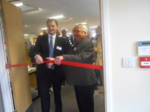 MP Luke Hall and Chair Dennis Rogers cutting the ribbon on our office open day